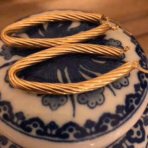 14 kt gold long oval hoop earrings.